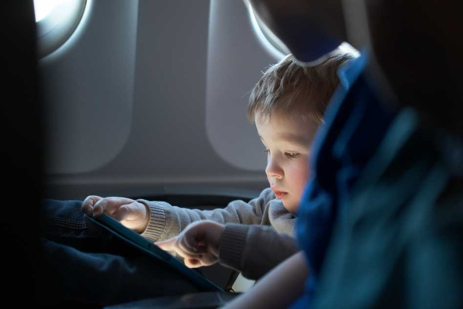 photodune-8124615-little-boy-traveling-in-an-airplane-s