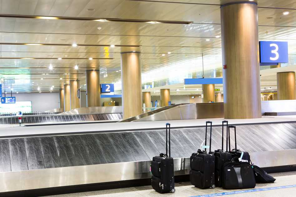 photodune-4173075-suitcases-at-airport-interior-at-baggage-claim-s